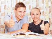 Two happy learning together in the classroom — Стоковое фото