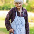 Elderly lonely woman in the nature — Stock Photo