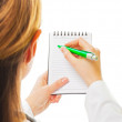 Young doctor writes something — Stock Photo #15452907