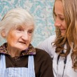 Old woman tells a story to the yung doctor — Stock Photo #15454103
