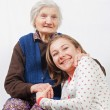 The sweet young girl and the old woman staying together — Stock Photo #15454947