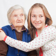 The sweet young girl and the old woman staying together — Stock Photo #15455007