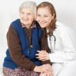 Old woman and the sweet young doctor staying together — Stock Photo #15455113