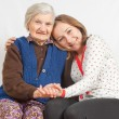 The sweet young girl and the old woman staying together — Stock Photo #15455221