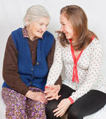 The sweet young girl and the old woman staying together — Stock Photo
