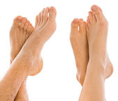 Young couples foot side by side — Stock Photo