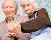 Old happy grandparents staying together — Stock Photo