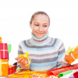 Sweet young girl with christmas present — Stock Photo