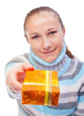 Sweet young girl with christmas presents — Stock Photo