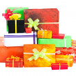 Stock Photo: Many isolated christmas present on white