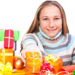 Stock Photo: Sweet young girl with christmas present