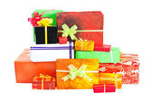 Many isolated christmas present on white — Stock Photo