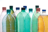 Plastic bottles in different color — Stock Photo