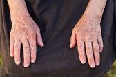 Elderly woman's hands — Stock Photo