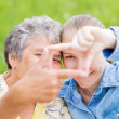 Elderly woman and her daughter — Stock Photo #25496417