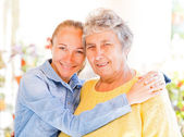 Elderly woman and her daughter — Stock Photo