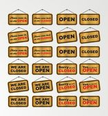 Open sign and closed sign with gold background — Stock Vector