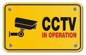 CCTV in operation yellow sign - rectangle sign — Stock Vector