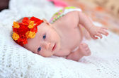 Beautiful smiling baby with a bright red color on the hair — Stock Photo
