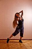 Beautiful girl with long hair dancing — Stock Photo