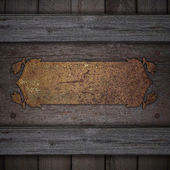 Wooden background with a rusty name metal plate with decoration. — Stock Photo