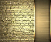 Brick wall is made ​​of gold with gold ribbon. Design template — Stockfoto