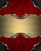 Motif sur une plaque en or sur fond rouge — Photo