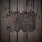Houten plaat op een houten achtergrond — Stockfoto