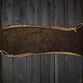 Rusty metal plate on a wooden background — Stock Photo