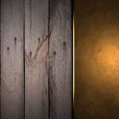 Gold plate on a beautiful wooden background — Stock Photo