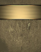 Grunge gold background with a gold nameplate for inscription — Stock Photo