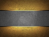 Beautiful gold background with a metal nameplate for writing. — Stockfoto