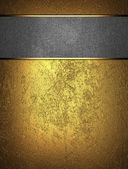 Gold background with a metal nameplate for writing — Stock Photo
