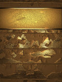 The template for the inscription. Golden shabby background. — Stok fotoğraf