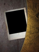 Old photos on a wooden background with gold edges. — Stock Photo