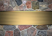 Beautiful stone background with a gold nameplate for writing. — Stock Photo