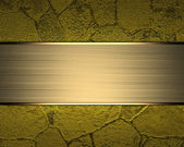 Beautiful gold background with a gold name-plate for writing. — Stock Photo
