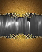 Gold background with a gold nameplate for writing. — Stock Photo