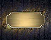 Black background with gold flower, and with a gold nameplate. — Stock Photo