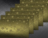 Metal background with gold nameplates adorned with stars — Stock Photo