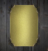 Wooden background with gold nameplate and gold ornament edges — Stock Photo