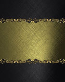 Black background with a gold name plate with patterns on the edges — Stock Photo