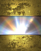 Old golden wall with nameplate of rays — Stock Photo