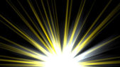 Star, sun with lens flare. Rays yellow of light on a black background — Stock fotografie