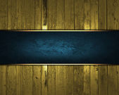 Gold wooden texture with blue nameplate for text — Stock Photo
