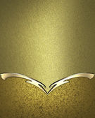 Gold texture with gold nameplate and a pattern on the edges — Stock Photo