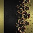 Black background decorated with golden hearts — Stock Photo #38441025