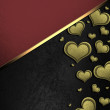 Golden hearts on a black background, with a red nameplate — Stock Photo #38443293