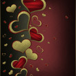 Golden hearts on a black background, with a red nameplate. — Stock Photo #38443309