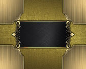 Gold texture with black nameplate with gold trim — Stock Photo